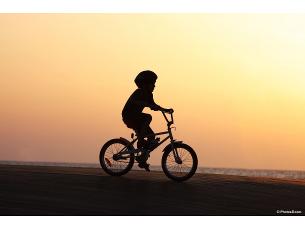 /sites/default/files/kid_on_bicycle_at_sunset-other.jpg
